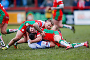 Keighley Cougars loose forward Mike Emmett (13) and Keighley Cougars hooker Nathan Conroy (9) in the tackle  during the Betfred League 1 match between Keighley Cougars and Workington Town at Cougar Park, Keighley, United Kingdom on 18 February 2018. Picture by Simon Davies.