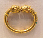 Gold and copper alloy bracelet with lion-head finials made from Gold, copper alloy. Cypriot 5th century B.C.