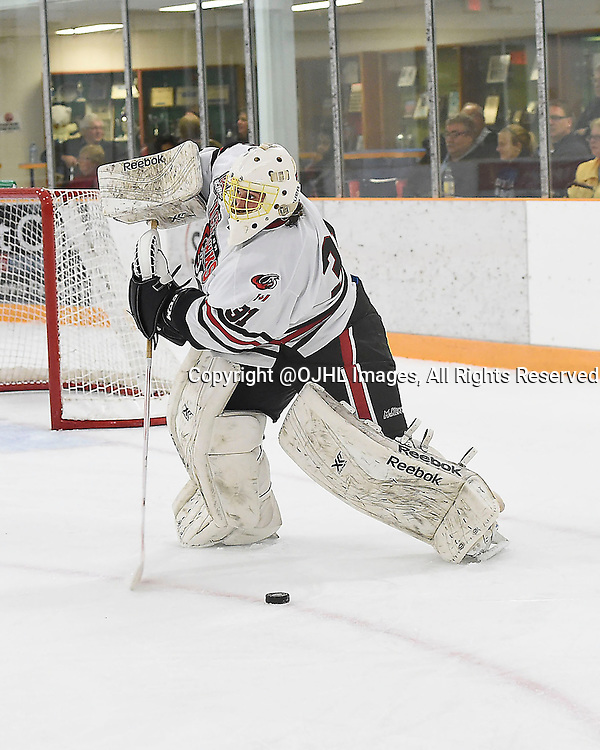 STOUFFVILLE, ON - Sep 12, 2015 : Ontario Junior Hockey League game action between Milton and Stouffville, Marcus Semiao #31 of the Milton Ice Hawks plays the puck during the first period.<br /> (Photo by Andy Corneau / OJHL Images)