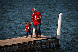 Father and son on a Lake Mendota pier in Madison, Wisconsin.