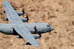 United States Air Force Lockheed HC-130J Combat King II from the 79th Rescue Squadron, Davis-Monthan Air Force Base, flies low level on the Jedi Transition through Star Wars Canyon / Rainbow Canyon, Death Valley National Park, Panamint Springs, California, United States of America