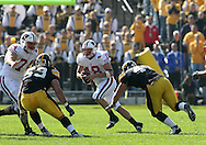 18 OCTOBER 2008: Wisconsin quarterback Dustin Sherer (18) scrambles from the defense in the first half of an NCAA college football game against Wisconsin, at Kinnick Stadium in Iowa City, Iowa on Saturday Oct. 18, 2008. Iowa won 38-16.