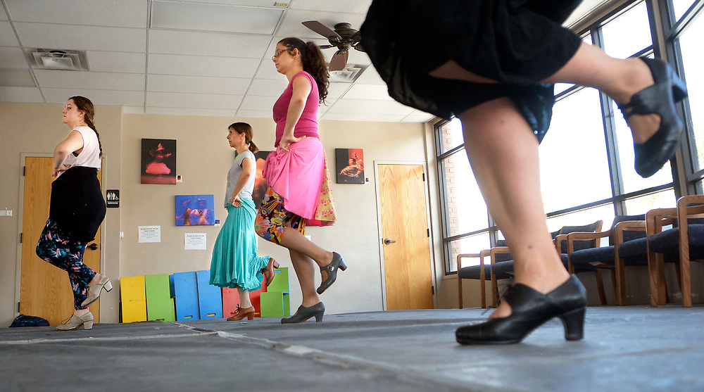 gbs072417d/ASEC -- Jillian Martinez, Barbara Gabaldon and Mariana Rosario, from left, all of Albuquerque do some footwork technique exercise during the lunch hour drop in class, Flamenco Power Hour, at the Conservatory of Flamenco Arts on Monday, July 24, 2017.  (Greg Sorber/Albuquerque Journal)