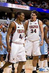 Virginia forward/center Ryan Pettinella (34) fires up team mate Virginia guard Sean Singletary (44) after hitting a shot and getting a foul call. The Virginia Cavaliers men's basketball team fell to the #3 ranked North Carolina Tar Heels 75-74 at the John Paul Jones Arena in Charlottesville, VA on February 12, 2008.