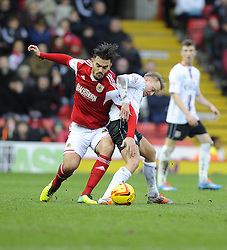 Bristol City's Marlon Pack battles for the ball with Milton Keynes Dons' Ben Reeves - Photo mandatory by-line: Joe Meredith/JMP - Tel: Mobile: 07966 386802 18/01/2014 - SPORT - FOOTBALL - Ashton Gate - Bristol - Bristol City v MK Dons - Sky Bet League One