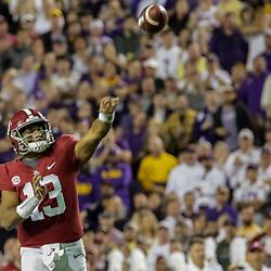 Nov 3, 2018; Baton Rouge, LA, USA; Alabama Crimson Tide quarterback Tua Tagovailoa (13) throws a touchdown against the LSU Tigers during the second quarter at Tiger Stadium. Mandatory Credit: Derick E. Hingle-USA TODAY Sports