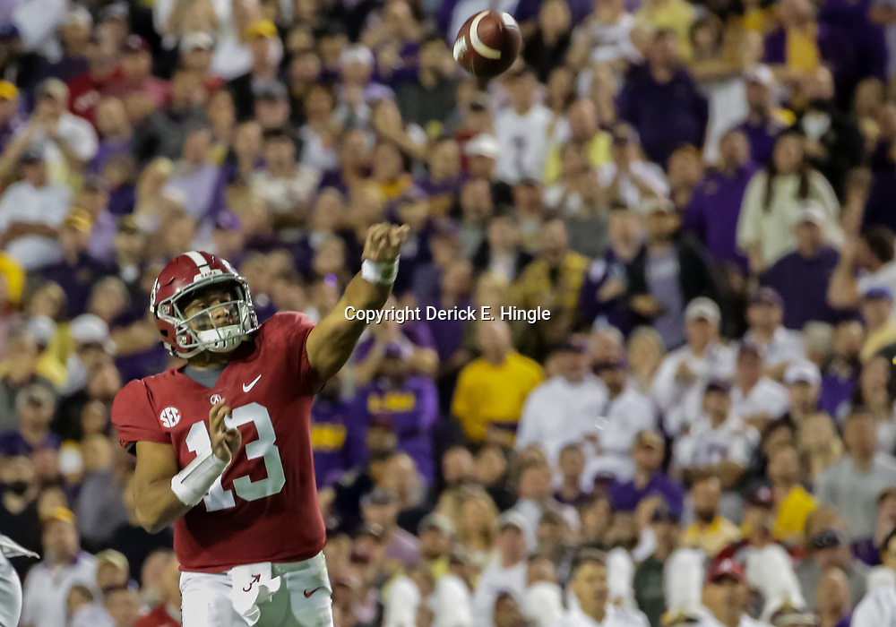 Nov 3, 2018; Baton Rouge, LA, USA; Alabama Crimson Tide quarterback Tua Tagovailoa (13) throws a touchdown against the LSU Tigers during the second quarter at Tiger Stadium. Mandatory Credit: Derick E. Hingle-USA TODAY Sports