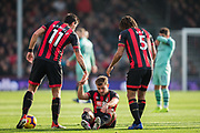 Ryan Fraser (Bournemouth) being helped up by Charlie Daniels (Bournemouth) Nathan Ake (Bournemouth) during the Premier League match between Bournemouth and Arsenal at the Vitality Stadium, Bournemouth, England on 25 November 2018.
