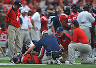 An injured Ole Miss' Jeff Scott (3) is assisted at Vaught-Hemingway Stadium in Oxford, Miss. on Saturday, September 3, 2011. BYU won 14-13.
