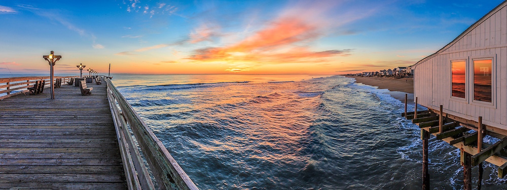 Panoramic view of Kitty Hawk Fishing Pier at sunrise on the Outer Banks of NC.