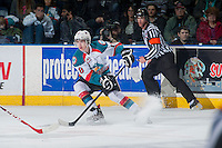 KELOWNA, CANADA - DECEMBER 30: Tate Coughlin #18 of Kelowna Rockets stops on the ice with the puck against the Prince George Cougars on December 30, 2014 at Prospera Place in Kelowna, British Columbia, Canada.  (Photo by Marissa Baecker/Shoot the Breeze)  *** Local Caption *** Tate Coughlin;
