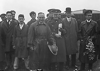 H784<br /> <br /> Bremen Flight 1928.<br /> <br /> The Bremen Crew and various people.<br /> <br /> Facing the camera, smiling, wearing trenchcoat and holding hat is Capt. K&ouml;hl.<br /> <br /> To the right of picture, holding upside-down bouquet of flowers is Baron von H&uuml;nefeld.<br /> <br /> (The first east-west non-stop transatlantic flight, in April 1928, from Baldonnel, Ireland to Greenly Island, Canada, in a Junkers W 33 monoplane, the &quot;Bremen&quot;. Crew of the Bremen: Pilot Capt. Herman K&ouml;hl, Navigator Col. Major James Fitzmaurice and Baron Ehrenfried G&uuml;nther Freiherr von H&uuml;nefeld, Owner of the plane).<br /> <br /> (Part of the Independent Newspapers Ireland/NLI Collection)