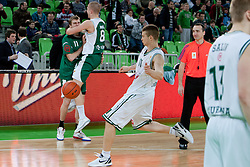 Players of KRKA Novo Mesto celebrate victory while Dino Muric kicks ball during basketball match between KK Union  Olimpija and and KK KRKA Novo Mesto in 20th Round of ABA League, on February 11, 2012, in Arena Stozice, Slovenia. (Photo by Matic Klansek Velej / Sportida)