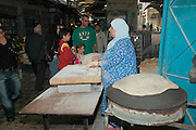 baking pita in the market in the narrow streets of old Akko<br /> Akko also Acre, is a city in northern Israel with a history spanning centuries. It also played a major role in the holy land crusades