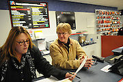 "TA Truck Service Center Assistant General Manager Bill Farntz (R) checks in with front-office Technical Service Advisor DeDe Mclaughlin in Morris, Illinois. Farntz credits Mclaughlin as the service facility's de-facto boss who gets things done, though it's sometimes best to ""stay out of her way""."