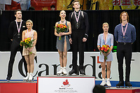 KELOWNA, BC - OCTOBER 26: Pairs silver medalists, Kirsten Moore-Towers and Michael Marinaro of Canada, gold medalists Aleksandra Boikova and Dmitrii Kozlovskii of Russia and bronze medalists Evgenia Tarasova and Vladimir Morozov of Russia stand on the podium during medal ceremonies of Skate Canada International held at Prospera Place on October 26, 2019 in Kelowna, Canada. (Photo by Marissa Baecker/Shoot the Breeze)