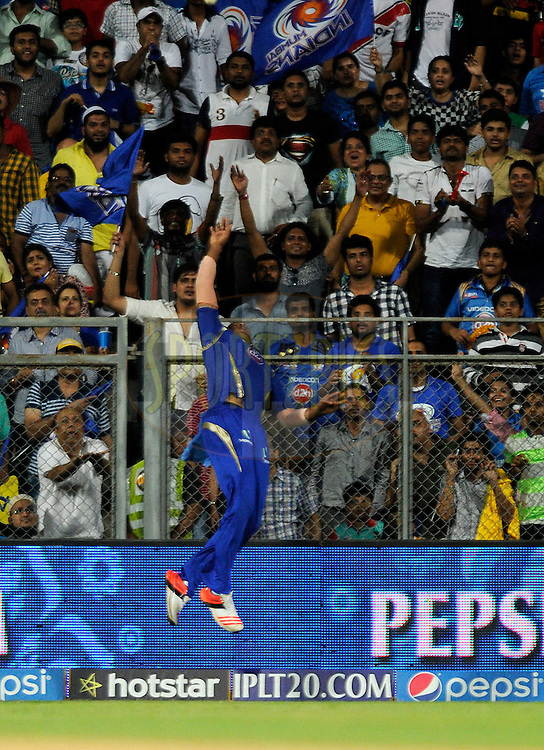 Kieron Pollard of Mumbai Indians attempts a catch during the qualifier 1 match of the Pepsi IPL 2015 (Indian Premier League) between The Chennai Superkings and The Mumbai Indians held at the Wankhede Stadium in Mumbai India on the 19th May 2015.<br /> <br /> Photo by:  Pal Pillai / SPORTZPICS / IPL