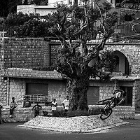 Watched by local kids, Kamil Tartarkovic finds some street playtime in Maasa Al Chouf, Lebanon.