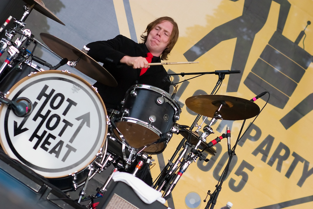 Paul Hawley of the Canadian band Hot Hot Heat pounds on the drums during the bands set at a Q101 radio festival in Chicago, IL.