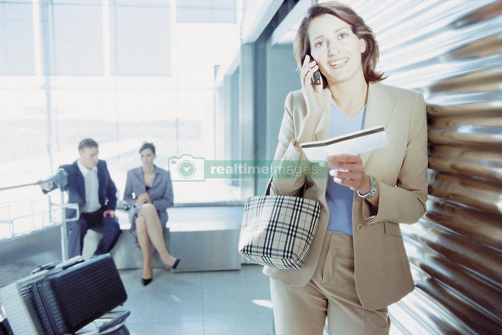 Dec. 05, 2012 - Businesswoman checking airline ticket (Credit Image: © Image Source/ZUMAPRESS.com)