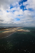 Nederland, Zuid-Holland, Gemeente Westland, 22-05-2011; Zandmotor, aanleg van kunstmatig schiereiland door het opspuiten van zand voor de kust ter hoogte van Ter Heijde. Wind, golven en stroming zullen het zand langs de kust verspreiden waardoor breder stranden en duinen ontstaan. De zandmotor is een experiment in het kader van kustonderhoud en kustverdediging. In de achtergrond de kassen van het Westland. Sand Engine or Sand motor, construction of artificial peninsula by the raising of sand for the coast of Ter Heijde (near the Hague). Wind, waves and currents will distribute the sand along the coast yielding wider beaches and dunes along the coastline . The Sand Engine is a experiment for coastal maintenance of coastal defense. In the background the Westland greenhouses..luchtfoto (toeslag); aerial photo (additional fee required); .foto Siebe Swart / photo Siebe Swart