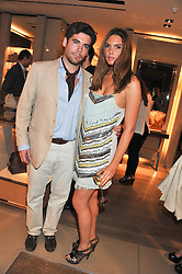 ALEXANDER FISKE-HARRISON and the HON.ANTALYA NALL-CAIN at a party as part of the Vogue Fashion's Night Out held at Tod's, 2-5 Bond Street, London on 6th September 2012.