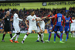 Luka Milivojevic of Crystal Palace steps in before trouble breaks out between the players - Mandatory by-line: Jason Brown/JMP - 18/03/2017 - FOOTBALL - Selhurst Park - London, England - Crystal Palace v Watford - Premier League