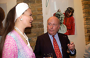 Lady Emma Kitchener Fellowes and Julian Fellowes, Shenda Amery studio party, Edith Grove, 20 July 2004. SUPPLIED FOR ONE-TIME USE ONLY-DO NOT ARCHIVE. © Copyright Photograph by Dafydd Jones 66 Stockwell Park Rd. London SW9 0DA Tel 020 7733 0108 www.dafjones.com