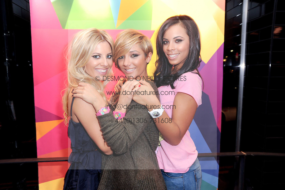 Left to right, MOLLIE KING, FRANKIE SANDFORD and ROCHELLE WISEMAN at a party to celebrate the Firetrap Watches and Kate Moross Collaboration Launch, held at Firetrap, 21 Earlham Street, London, UK on 13th October 2010.