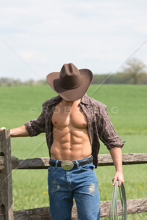 hot cowboy with an open shirt at a ranch
