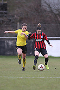 Megan Wynne and Lucy Somes jossle during the Women's FA Cup match between Watford Ladies FC and Brighton Ladies at the Broadwater Stadium, Berkhampstead, United Kingdom on 1 February 2015. Photo by Stuart Butcher.