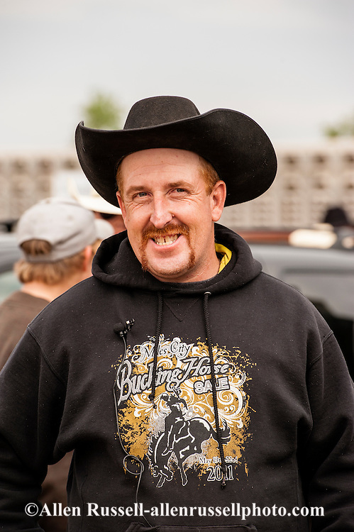 Miles City Bucking Horse Sale, Wild Horse Race, anchor, Kirk McCarville, cowboy, Montana, MODEL RELEASED.