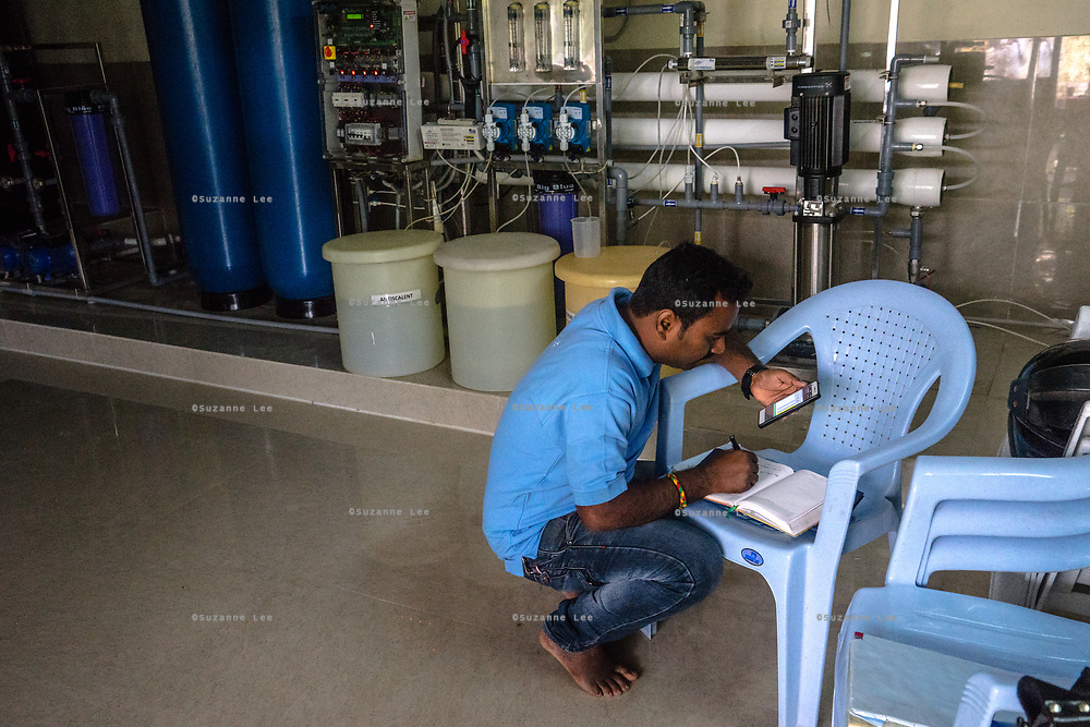 A Safe Water Network employee stands inside an  iJal station in Rangsaipet, in Waragal, Telangana, Indiia, on Saturday, February 9, 2019. Photographer: Suzanne Lee for Safe Water Network