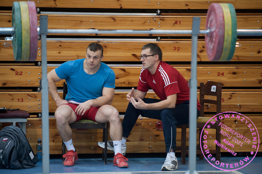 (L) Adrian Zielinski from Poland (Tarpan Mrocza; category 85 kg) and (R) his trainer coach Jerzy Sliwinski during training session two weeks before weightlifting IWF World Championships Wroclaw 2013 at the Olympic Sports Centre in Spala on October 08, 2013.<br /> <br /> Poland, Warsaw, September 16, 2013<br /> <br /> Picture also available in RAW (NEF) or TIFF format on special request.<br /> <br /> For editorial use only. Any commercial or promotional use requires permission.<br /> <br /> Mandatory credit:<br /> Photo by &copy; Adam Nurkiewicz / Mediasport