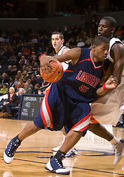 Liberty guard Anthony Smith (5) dribbles past Virginia guard/forward Mamadi Diane (24).  The Virginia Cavaliers fell to the Liberty Flames 86-82 in NCAA Division 1 men's basketball at the University of Virginia's John Paul Jones Arena  in Charlottesville, VA on March 9, 2008.