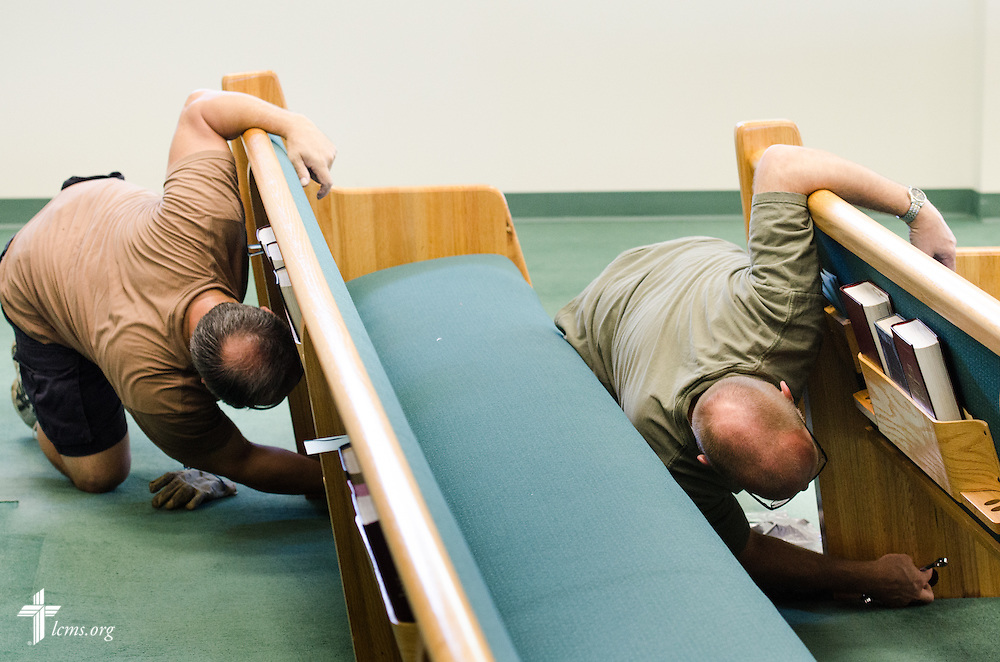 Volunteers remove the pews from the soaked carpet of St. Matthew Lutheran Church on Saturday, May 3, 2014, in Pensacola, Fla., Torrential rainfall led to widespread flooding in the area, damaging the fellowship hall and sanctuary of the church. LCMS Communications/Erik M. Lunsford