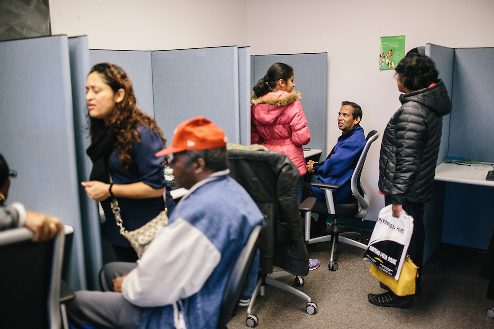 Sugeesha Perera, right, hits a snag when his social security wouldn't register while attempting to sign up his family for health insurance at the Montgomery County Department of Health and Human Services on Dec. 7, 2013. Maryland's state-run health-insurance exchange is lagging behind other states, despite strong support among Maryland leaders for President Barack Obama's health law. Only 3,000 acquired private health coverage in the first two months in a state with about 600,000 uninsured. CREDIT: Greg Kahn for The Wall Street Journal. MARYLAND