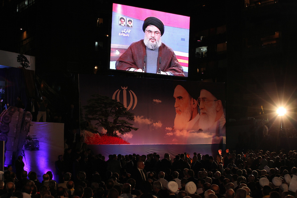 Iranian President Mahmoud Ahmadinejad arrived in Beirut this morning for the start of a two-day trip to Lebanon. After visits around Beirut, Ahmadinejad ended the day by speaking at a Hizballah-organized rally attended by tens of thousands in Beirut's southern suburbs. At the rally, Hizballah head Hassan Nasrallah also addressed the crowd from a video link.///Hizballah head Hassan Nasrallah addresses the crowd in Dahiyeh via video link.