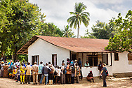 Patients listen as the Rev. Gary Schulte, area director for West and Central Africa, leads a devotion on the first day of the LCMS Mercy Medical Team on Monday, May 7, 2018, in the Yardu village outside Koidu, Sierra Leone, West Africa. LCMS Communications/Erik M. Lunsford
