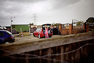 UNITED KINGDOM, Basildon: A young Irish Traveller prepares to leave as eviction looms on the traveller settlement at Dale Farm near Basildon, Essex, south east England, on September 17, 2011. © Christian Minelli.