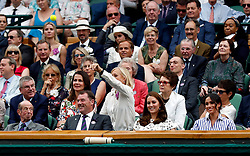The Duchess of Cambridge and the Duchess of Sussex in the royal box on centre court as Martina Navratilova catches a tennis ball and throws it back onto court on day twelve of the Wimbledon Championships at the All England Lawn Tennis and Croquet Club, Wimbledon.