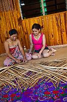 Woman weaving making mats in Nanga Sumpa Longhouse.