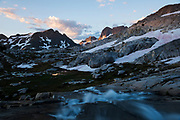 Sunrise landscape shot of Minarets with stream at Nydiver Lake in the Ansel Adams Wilderness. High Sierra backpacking trip to Garnet Lake and Nydiver Lake in the Ansel Adams Wilderness out of Devil's Postpile national monument 2017.