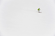 A skier/snowboarder descends on a run at Grand Hirafu resort in the Niseko ski region of Hokkaido, Japan on Feb. 9 2010. Niseko is made up of 57 runs  totaling over 47 km in groomed slopes and is the only resort area in Japan where off-piste skiing and boarding is legal.