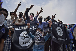 June 15, 2018 - Anantnag, Jammu and Kashmir, India - Kashmiri protesters raised Islamic state flags during a peaceful protest at Lal Chowk Anantnag on 15 June 2018..Protesters raised IS flags for first time ever in history of Anantnag District. (Credit Image: © Zafar Dar/Pacific Press via ZUMA Wire)