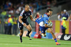 Dillyn Leyds of the DHL Stormers evades the tackle during the Super Rugby match between the DHL Stormers and the Vodacom Blue Bulls at Newlands Stadium in Cape Town on the 25th February 2017