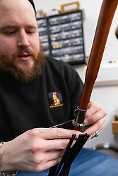 The ribs are fitted to an umbrella by umbrella maker Lee. Craftspeople at Fox Umbrellas Ltd, a company in Croydon, Surrey, that has been going for over 150 years hand build quality umbrellas. Croydon, Surrey, March 06 2019.