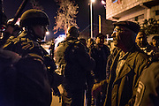 An elderly Palestinian man talks to an Israeli soldier who refused to intervene as Jewish settler Anat Cohen caused chaos and panic during a peaceful commemorative evening in Hebron.