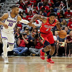 Oct 19, 2018; New Orleans, LA, USA; New Orleans Pelicans guard Elfrid Payton (4) drives past Sacramento Kings guard Frank Mason III (10) during the first quarter at the Smoothie King Center. Mandatory Credit: Derick E. Hingle-USA TODAY Sports