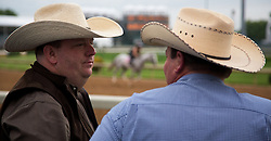 Kenny Flanagan of Erick, OK, left, and Justin Jordan watch workouts Friday, May 03, 2013 at Churchill Downs in Louisville. <br /> <br /> Flanagan owns horses but doesn't have one in the Derby this year. Derby winning trainer Chip Wooley trains some of Flanagan's horses. Photo by Jonathan Palmer